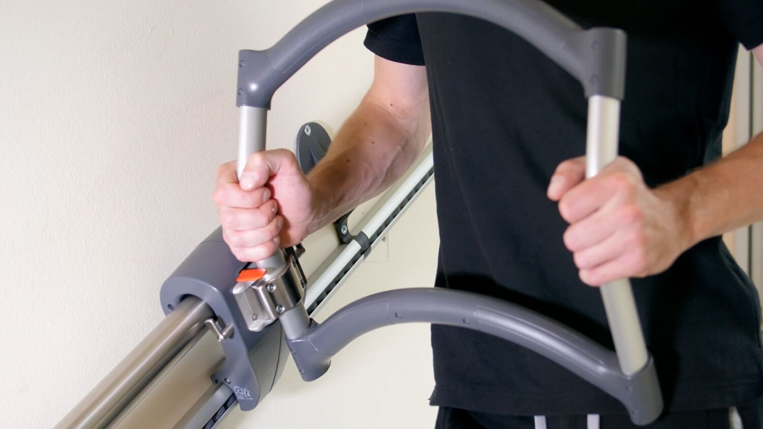 Holding the stairwalker AssiStep during rehabilitation from spinal cord injury