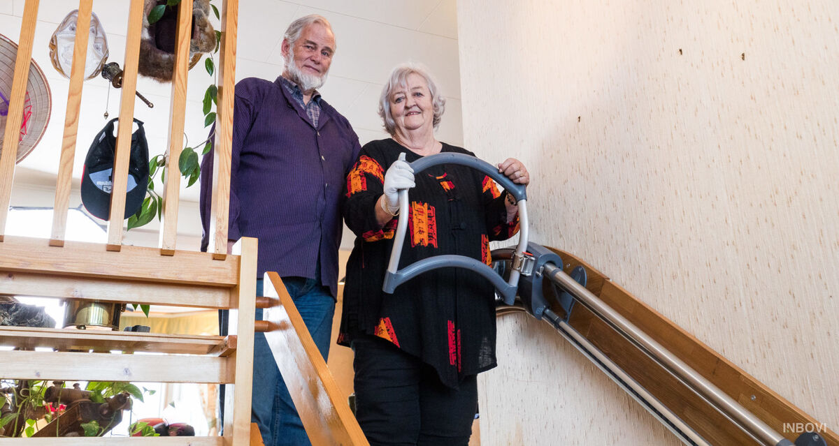 Old couple with the stair walker AssiStep